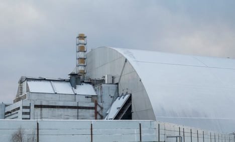 A general view shows a New Safe Confinement structure over the old sarcophagus covering the damaged fourth reactor at the Chernobyl nuclear power plant, in Chernobyl