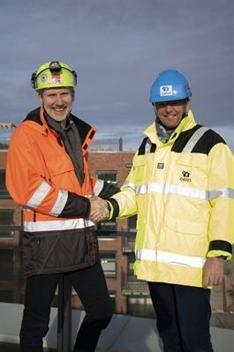 Konserndirektør Hans Olav Sørlie i Veidekke Bygg og konserndirektør for boligutvikling Arne Baumann i OBOS