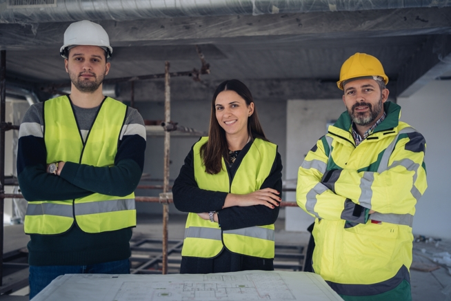 Portrait of young engineers at construction site