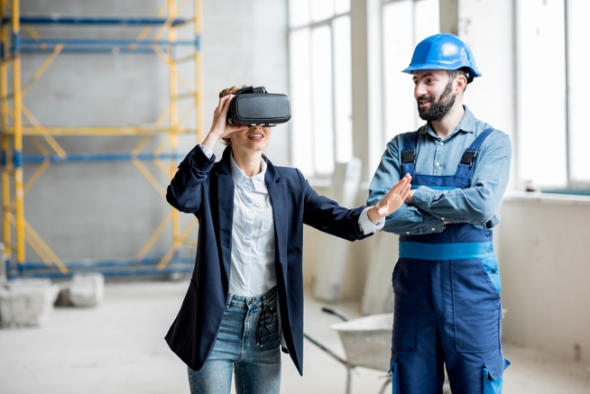 Woman client wearing VR glasses at the construction site